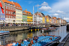 Nyhavn is a waterfront,canal and entertainment district in Copenhagen, Denmark (dorosario-photos) Tags: city buildings copenhagen denmark boats nyhavn canal europe waterfront harbour tourists danish scandinavia danes northeurope colourfulbuildings boatcruises