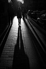 Walk into the light No. 2 - Cork (Pat Kelleher) Tags: light shadow summer blackandwhite bw sunlight blancoynegro blanco contrast dark und fuji candid cork shade weiss schwarz enblancoynegro corkstreetphotography patkelleherphotography x100t fujix100t