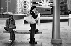 Happy Food, Happy Thoughts (burnt dirt) Tags: houston texas downtown mainstreet city town street people person girl woman bw streetphotography asian food burger eating happy smile couple metro busstop waiting
