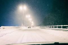 Winter Bliss (Georgi C) Tags: driving bliss winter night snow snowing road roads cars light street streets lights city citylights fujifilmx100t fujifilm