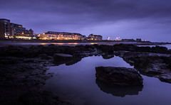 Porthcawl (Red King (Rory)) Tags: seascape sea sky sunset water rocks lights reflection