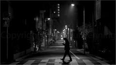 """""""Walking and Texting"""" Asakusa, Tokyo, Japan (December 2016) (Kommie) Tags: asakusa tokyo japan black white japanese fujifilm xpro2 fujinon 56mm f12 r low light photography night bokeh street"""
