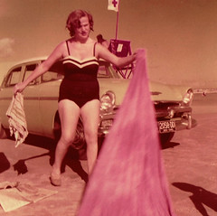 At the Beach (~ Lone Wadi ~) Tags: kodacolor swimsuit swimwear beach sunbather sun sand surf car automobile vacation lostphoto retro 1950s unknown