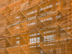 I Have Got You Covered (Steve Taylor (Photography)) Tags: netting scaffold architecture building window scaffolding orange monocolor monocolour fabric steel metal glass newzealand nz southisland canterbury christchurch cbd city diagonal cover brilliant
