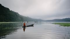Tamblingan's Fisherman (eggysayoga) Tags: morning people bali mist lake film fog sunrise indonesia landscape boat nikon kodak tokina human activity portra perahu danau emulation nelayan jukung tamblingan kabut d7100 1116mm vsco emulasi