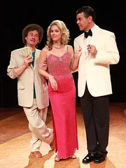 """Timothy Gulan (left) as Freddy Benson, Jessica Rush as Christine Colgate and Burke Moses as Lawrence Jameson in the Music Circus premiere of """"Dirty Rotten Scoundrels"""" at the Wells Fargo Pavilion August 3-8, 2010.  Photo by Charr Crail."""