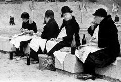 Robert Capa  International Center of Photography FRANCE. Calvados. Lisieux. Ca. 1936. Pilgrimage of Saint Theresa (gorbutovich) Tags: hat bottle picnic catholic exterior wine eating drinking chapeau manger vin whitepeople seated extrieur pilgrimage assis bouteille boire piquenique lisieux worshiper catholique plerinage fidle woman60yearsandolder typehumainblanc femme60ansetplus