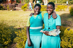 Uganda: High school scholarship program for orphans striving toward sustainability thanks to tuition-paying students; recent harvest success (Peace Gospel) Tags: school girls friends sun love nature students girl beautiful beauty smile sunshine smiling sisters happy hope student hug