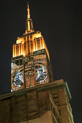 The Empire State Building (mudpig) Tags: city nyc animal night skyscraper outdoors photography star tiger projection esb species empirestatebuilding endangered lightshow nuevayork specialevent cidadedenovayork mudpig stevekelley      lavilledenewyork stevenkelley racingextinction