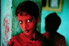 Steve McCurry-3 (tengseangy) Tags: 1996 bombay mumbai india horizontal portrait outdoors outside exterior child children kid kids boy boys young festival tradition custom celebration religious religion faith ganesh ganpati face facial paint painted cover covered covering dust powder lean leaning pillar shadow shadows silhouette silhouettes eyes teal turquoise blue red black 0006614 1292035 india10209nf