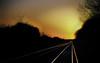 Sunset Rails (Re-Edit) (JDWCurtis) Tags: oving england southengland rail railway railtracks tracks railwaytracks lines sunset sun orange reflections reflection silhouette silhouettes leadinglines