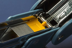 Macro Mondays – Contraption (Explored 30-Jan-17) (Kev Gregory (General)) Tags: macromondays contraption staple stapler machine hand held yellow blue device metal paper spring loaded press punch detail close up hinged hinge charge working slide silver row sharp secure kev gregory canon 7d macro mondays 100 100mm f28 usm ef challenge theme explore explored