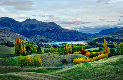 The View from Sir Michael hill's Home (Stuck in Customs) Tags: autumn newzealand queenstown thehills trey ratcliff stuckincustoms stuckincustomscom treyratcliff rr dailyphoto horizontal colour color art sculpture golfcourse bridge pond sunset man reflection water sky cloud green grass blue white tussock trees willow mountain rock stone glare sun orange yellow brown fawn grey black dusk red metal standing otago southisland michaelhill millbrook arrowtown outdoor serene april 2016 p2017 bright landscape hasselbladh5d