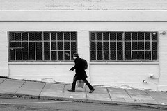 Uphill Rush (Ian Sane) Tags: ian sane images uphillrush man walking uphill warehouse windows black white monochrome candid photography northwest portland oregon canon eos 5d mark ii two camera ef70200mm f28l is usm lens