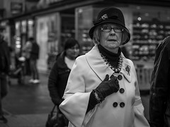 In A Flap (Leanne Boulton) Tags: people monochrome urban street candid portrait portraiture streetphotography candidstreetphotography candidportrait streetportrait eyecontact candideyecontact streetlife elderly old woman female face facial expression eyes look emotion feeling mood atmosphere glare stare glasses style stylish fashion retro vintage 1920s 1930s flapper tone texture detail depthoffield bokeh dark natural outdoor light shade city scene human life living humanity society culture canon 5d 5dmkiii 70mm character ef2470mmf28liiusm black white blackwhite bw mono blackandwhite glasgow scotland uk