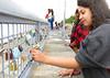 Georgina and Sharma on the Manila sea wall 0094 (Tony Withers photography) Tags: tonywithers philippines 2017 mallofasia moa seawall manilabay locks fence padlocks wishes love lovelocksinmanila