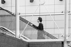 Going up (erikinlondon) Tags: man monochrome framed candid escalator streetphotography pedestrians bnw