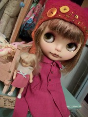 Orphan and her lil' dolly......