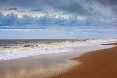 Rehoboth Beach, Delaware (Atomic Eye) Tags: rehoboth beach delaware sussexcounty surf ocean sand clouds caperegion waves vacation destination water landform landscape coast pebbles seashore