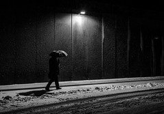 snowy streets (Georgie Pauwels) Tags: street snow streetphotography umbrella darkness fujifilm blackandwhite