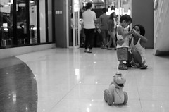 (RM Ampongan) Tags: life street city white playing black mall toy photography sister brother philippines human sur activity region bicol camarines iriga
