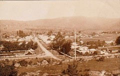 Tumut Street, Adelong, New South Wales - from the west end (Aussie~mobs) Tags: adelong newsouthwales australia tumutstreet vintage sepia township houses aussiemobs