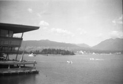 watching planes (620 film) (Prestonbot) Tags: kodakbrownietargetsix20 620film vancouverbc pacificocean stanleypark mountains harbour westcoast britishcolumbia vancouverconventioncentre planes airplanes seaplanes