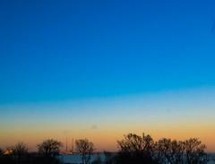 Dublin Bay sunset (Steve-h) Tags: nature natur natura naturaleza sunset dublinbay pigeonhousechimneys trees hospital colour colours blue orange yellow red blackrock ðublin ireland europe winter january 2017 digital exposure cameraphone iphonography appleiphone6s steveh