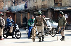 A Kashmiri man riding a scooter  stopped an Indian paramilitary soldier at an temporary checkpoint during curfew in Srinagar, Indian controlled Kashmir, Thursday, Feb. 9, 2017. Shops and businesses shut in the Indian-controlled part of Kashmir on Thursday (faizanaltaf) Tags: kpc ajeinpictures kashmirnow gettyimages pic captivingkashmir photo wordpressphoto picture photos pics guardiantravelssnaps clickbastar dailylifekashmir natgeoyourshot