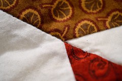 Quilted Corners (mslabrat13) Tags: macromonday corner macro quilt fabric red cmwdred