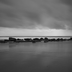 Rock line. Had some fun with welding glass. (Murdoch333) Tags: water mood clouds blackandwhite sea prime fujifilm xpro weldingglass longexposure coast rocks