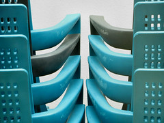 Arm in arm (Claire Wroe) Tags: plastic blue black chair arm armrest work manchester cty coop cooperative angel square back hole pattern repeat curve scuff