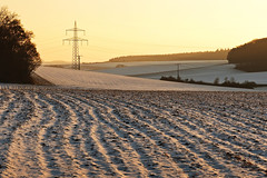 The big and the small (Claudia G. Kukulka) Tags: tree baum trees bäume field feld path track weg feldweg snow schnee winter sky himmel transmissiontower powerpole strommast sunset sonnenuntergang
