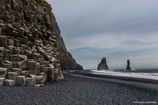 Black Sand Beach, Vik (Vikurbraut), South Iceland with the iconic hexagonal basalt columns on the left and the Reynisdrangar on the right