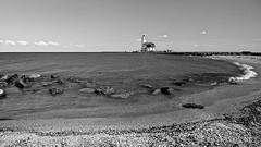 Het Paard van Marken (stavos) Tags: blackandwhite bw lighthouse white black holland beach water netherlands canon landscape rocks wideangle shore marken paard 10mm 550d stavosnl