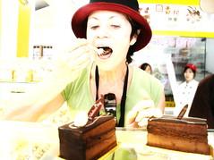 The Cake Eater (johey24) Tags: china portrait people food cake closeup exposure raw yangshuo candid highlights enjoyment 60thbirthday peoplewatching inyourface strongwomen damama janineinchina womenwithgutso travelforyour60thbirthday