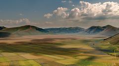 Sun and Clouds, Light and Shadows (RobiG60) Tags: mountains montagne nuvole ombre plain pianura geometrie castelluccio fioritura