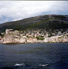 img369 (foundin_a_attic) Tags: sea water lake wet waves glass slide 77 medium format slides corfu view houses stone green hill rocks cliff wave dubrovnik old city walls right