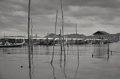 Langkawi Island Hopping Jetty (Arushad) Tags: arushad clouds travel arushadahmed boats bw dash8x dusk hills holiday island jetty kedah langkawi malaysia sea serene sky sticks tropical