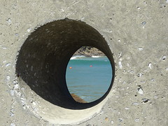 Through the round window...... (Amo535) Tags: coast beach water sea defence coastal bikinibeach capetown southafrica