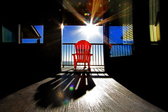 shadows of the living (1crzqbn) Tags: ocean red sunlight color reflections shadows balcony textures refractions sunflare hss nyebeach emptychair 1crzqbn