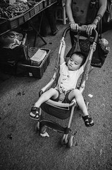 strollers (Laixiang Pow) Tags: life camera people bw baby white black streets cute monochrome photography kid asia earth mother like human f malaysia gr 28 mm ricoh 黑白 夜市 melaka malam malacca pasar strollers 馬來西亞 馬六甲 麻六甲 理光 街頭攝影