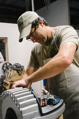 A Pika technician assembles the nacelle of a U.S.-made Pika T701 wind turbine
