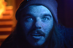 Black Light (CrackerBrush) Tags: black light blacklight portrait dylan freckles zombie blue