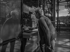0A7_DSC2092 (dmitry_ryzhkov) Tags: art city europe russia moscow documentary journalism street urban candid life streetlife outdoor streetscene close scene streetshot image streetphotography candidphotography streetphoto moment light shadow photography shot people population resident inhabitant person live portrait streetportrait candidportrait unposed public face eyes look stranger woman women lady sony alpha black blackandwhite bw monochrome white bnw blacknwhite reflection cashdesk kid kids parent girl children girls day daylight