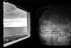 """""""Με αγγίζει η φωτογραφία που σκιαγραφεί αυτό που δεν εξυπακούεται.""""  -Nikos Aliagas- (Georgina ♡) Tags: abandonedbuilding athens greece sea mountains windowframe blackandwhite monochrome nikosaliagas cloudy"""