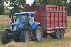 New Holland T7.200 Tractor with a Broughan Engineering Mega HiSpeed Trailer (Shane Casey CK25) Tags: new holland t7200 tractor broughan engineering mega hispeed trailer nh cnh blue midleton t7 200 newholland grain harvest grain2016 grain16 harvest2016 harvest16 corn2016 corn crop tillage crops cereal cereals golden straw dust chaff county cork ireland irish farm farmer farming agri agriculture contractor field ground soil earth work working horse power horsepower hp pull pulling cut cutting knife blade blades machine machinery collect collecting nikon d7100 tracteur traktor traktori trekker trator ciągnik