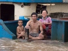 Bath on board, on the Ton le Sap River, Cambodia (David Keljo) Tags: family bathing river cambodia boat