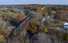 Maine Central over Fairfield (Thomas Coulombe) Tags: panamrailways panam mainecentral mec52 guilfordrailsystem guilford gp9 emdgp9 heritageengine nmwa freighttrain train bridge trestle kennebecriver fairfield drone dji phantom aerial