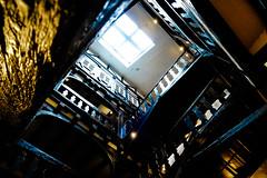 12-08-05 stairs up fürstenberg  p1010052 (u ki11 ulrich kracke) Tags: froschp fürstenberg gitter licht spirale treppe treppenhaus x much